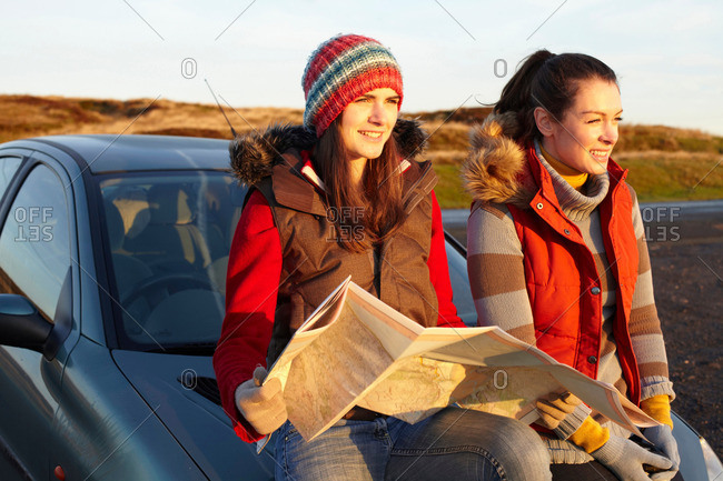 Women reading map by car