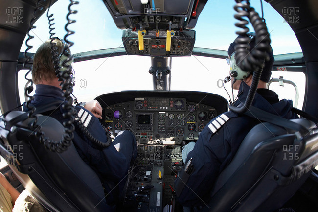 Helicopter pilots in cockpit