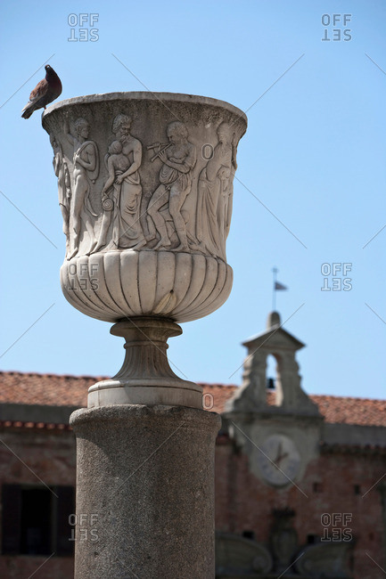 Pigeon perched on ornate statue
