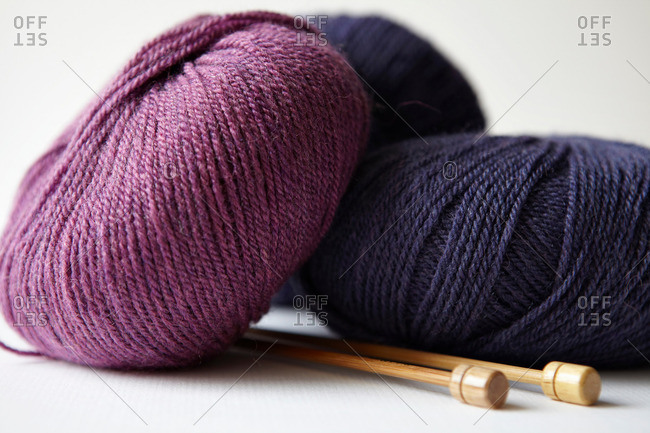 Skeins of yarn and knitting needles