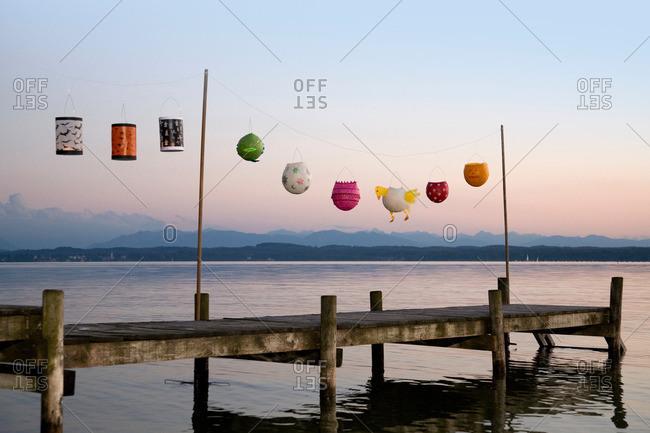 Paper lanterns strung up on wooden pier