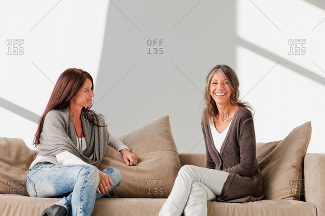 Older women relaxing together on sofa