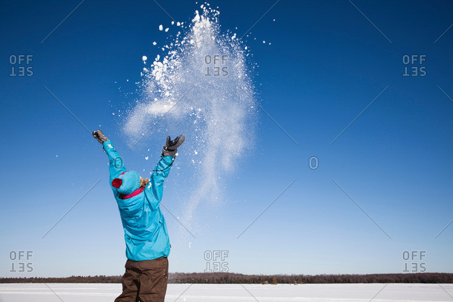 Woman playing with snow outdoors