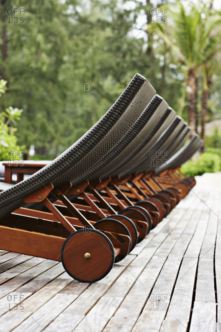 Lawn chairs lined up on wooden deck