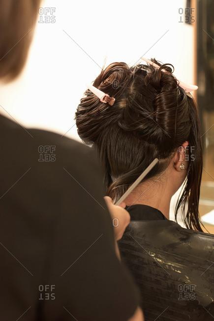 Hair stylist working on clients hair