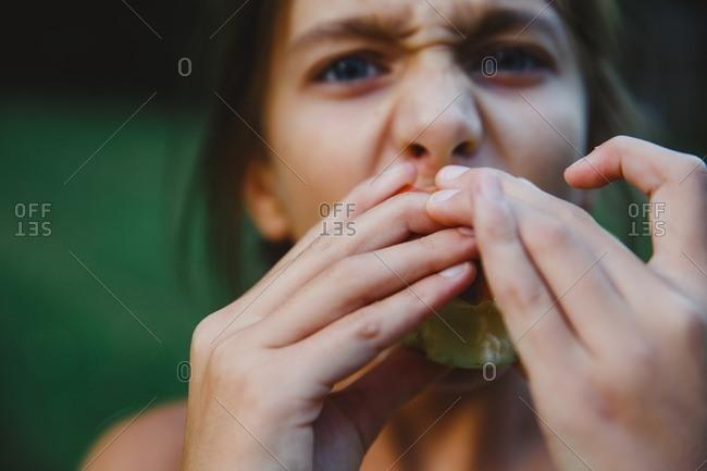 Portrait of girl eating apple