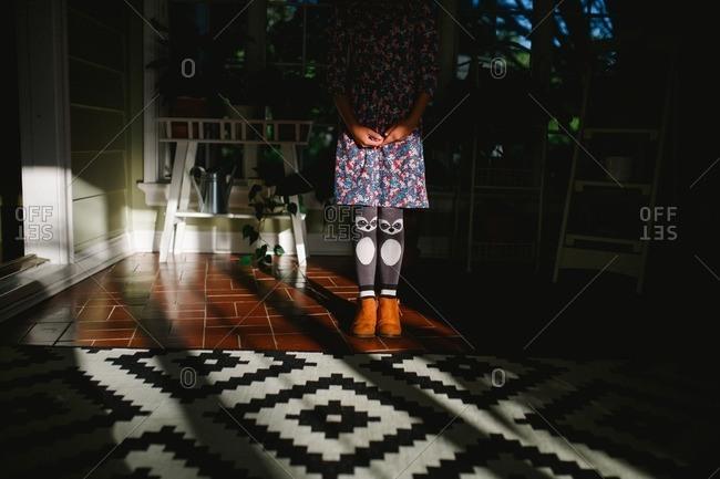 Girl wearing raccoon socks and flower dress