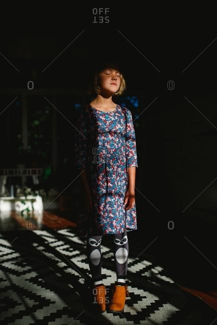 Girl in raccoon socks and flower dress