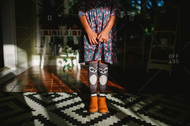 Girl with raccoon socks and flower dress