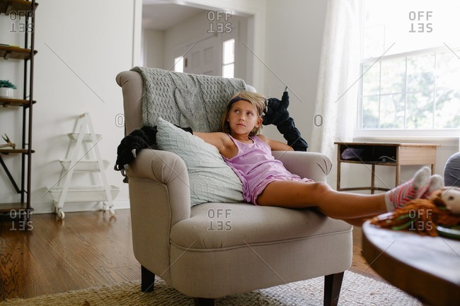 Girl in chair with monster hands