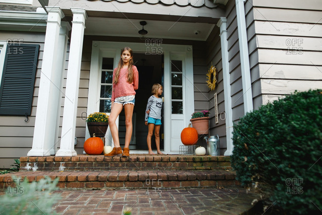 Girls on a front porch with fall d�cor