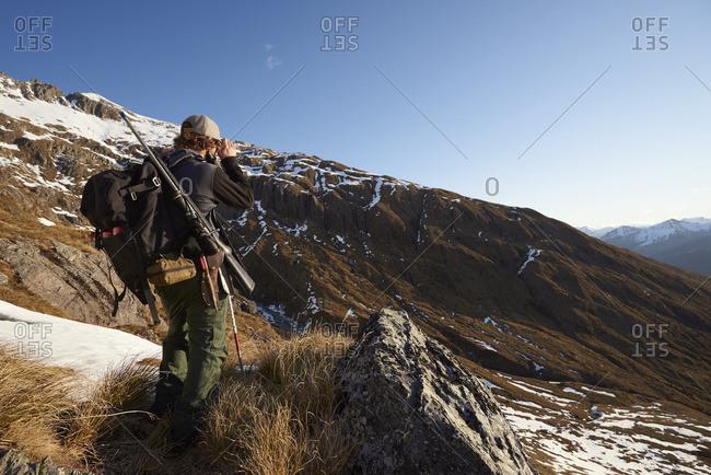 Hunter looking at a mountain ridge
