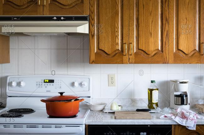 Orange pot on stove in kitchen