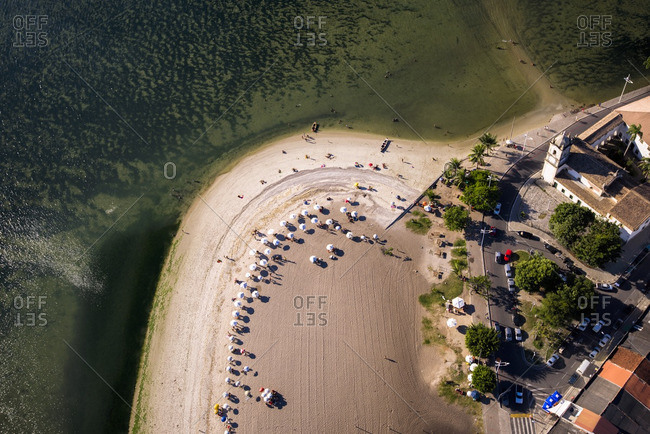 Aerial view of umbrellas and beachgoers at All Saints Bay, Salvador da Bahia
