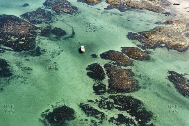 Aerial view of boat among coral reef in Salvador, Brazil