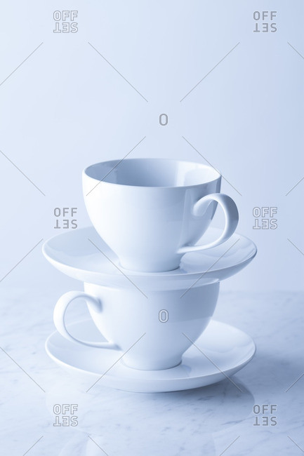 Stack of two white porcelain teacups