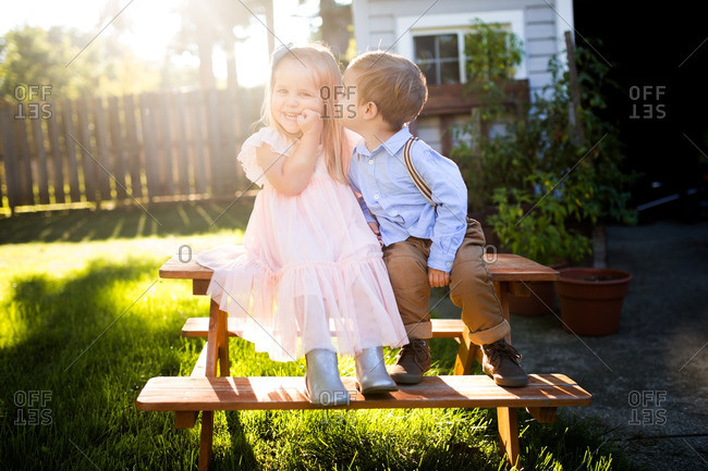 Boy kissing girl on a picnic table