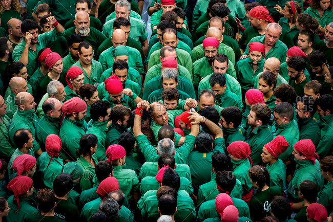 Members of the 'Gausacs' human tower team before forming a 'castell' (human tower) during the XXVI human towers, or 'castells', competetion in Tarragona on October 1, 2016.