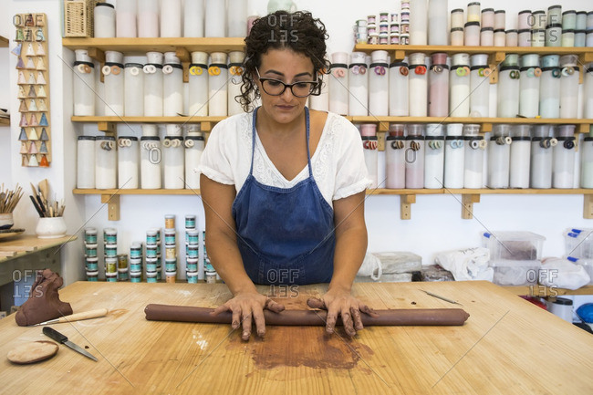 Woman working with clay in a ceramics workshop