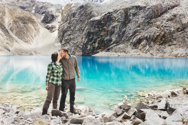 Peru Cordillera Blanca Huaraz Huascaran National Park couple kissing at Laguna 69