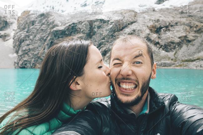 Peru Cordillera Blanca Huaraz Huascaran National Park selfie of happy couple at Laguna 69