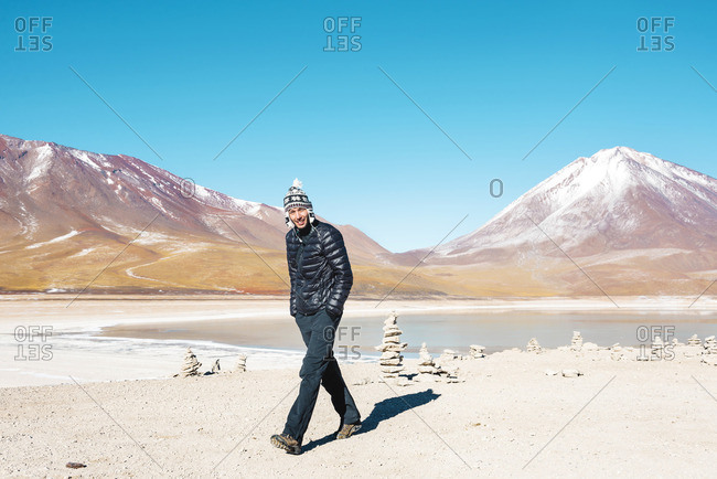Bolivia Eduardo Avaroa Andean Fauna National Reserve Man wearing chullo walking at Laguna Verde