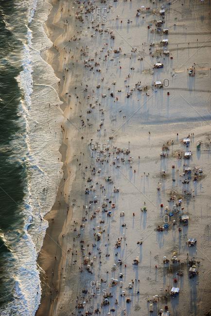 Brazil Rio de Janeiro Aerial photograph of Ipanema Beach with weekend crowds