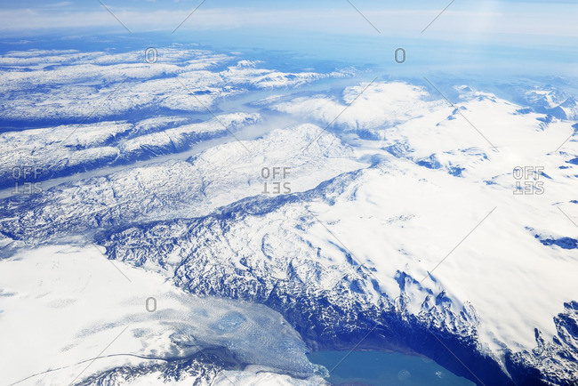 Greenland view out of plane window on glaciers fjords sea and mountains