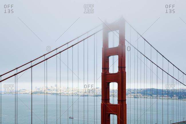 USA California San Francisco Golden Gate Bridge in fog as seen from Battery Spencer