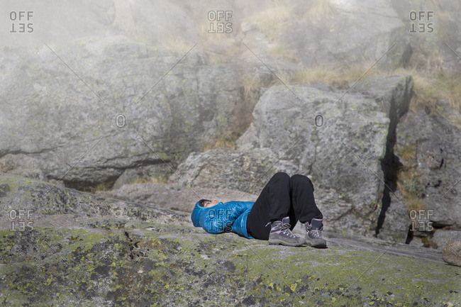 Spain Sierra de Gredos woman resting in the mountains