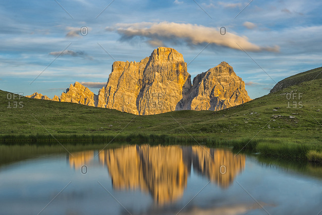 Italy Dolomites view to Mountain Pelmo and Lago Delle Baste in the foreground by sunset