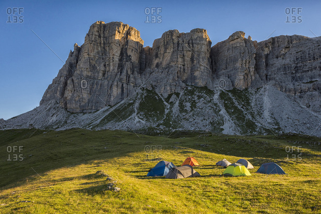 Italy Dolomites view to Mountain Lastoi de Formin with camp in the foreground