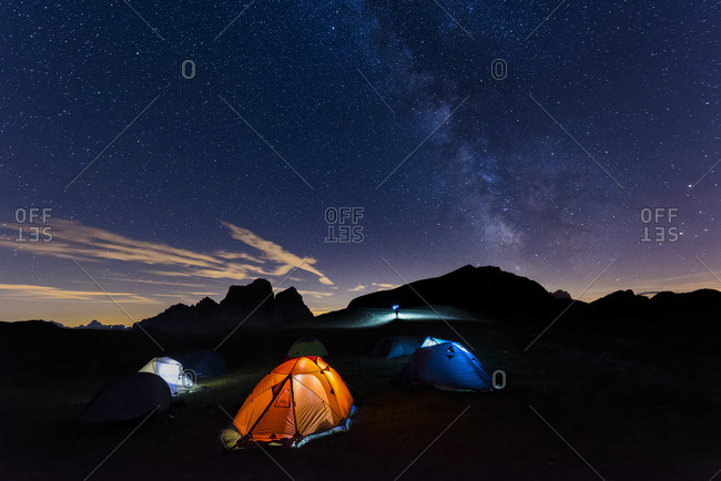 Italy Dolomites Milky Way over Monte Pelmo with tents of camp in the foreground