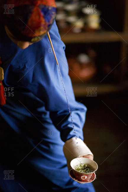 Waiter trick pouring during a Chinese tea ceremony.