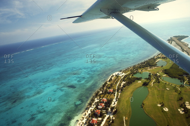 View of a beach resort and the ocean from a plane.