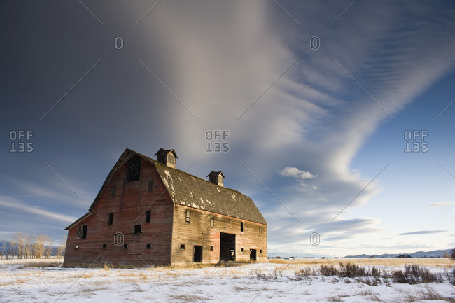 Abandoned barn on a farm in winter.