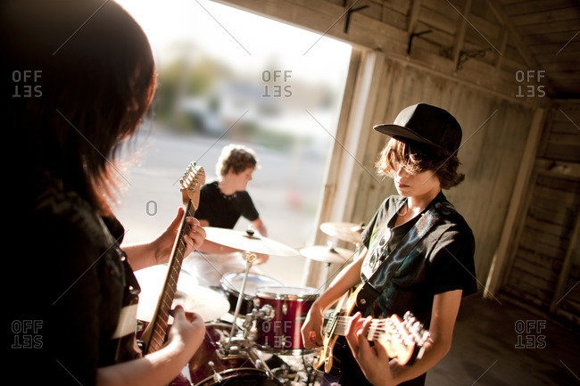 Band rehearsing in their garage.