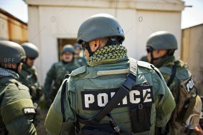 Military police wearing bullet proof vests.
