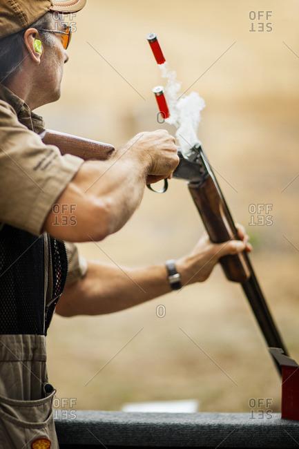 Man shooting at a firing range.