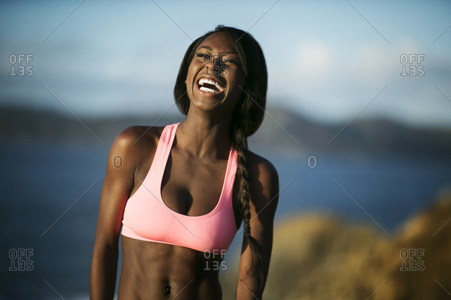 Smiling young woman in active wear.