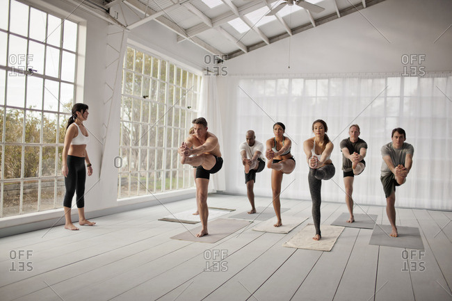 Group of people in a yoga class.