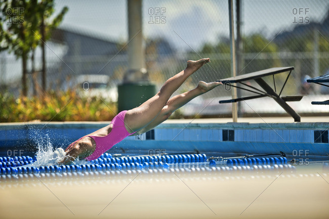 Woman diving into a swimming pool.