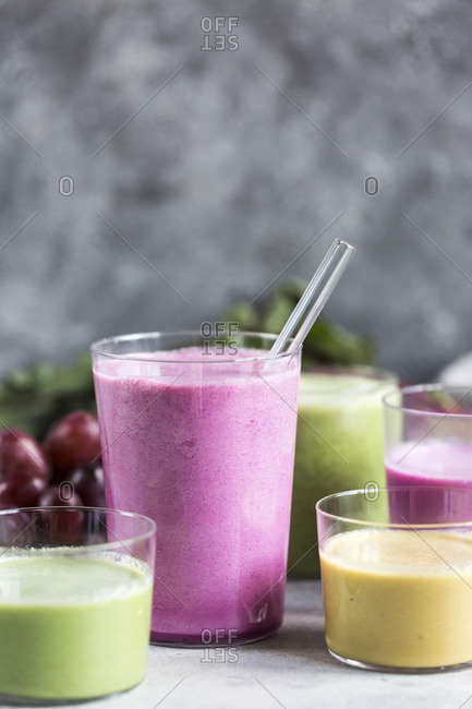 Several glasses of multi-colored beet smoothies