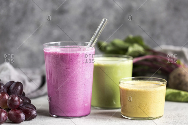 Three glasses of multi-colored beet smoothies