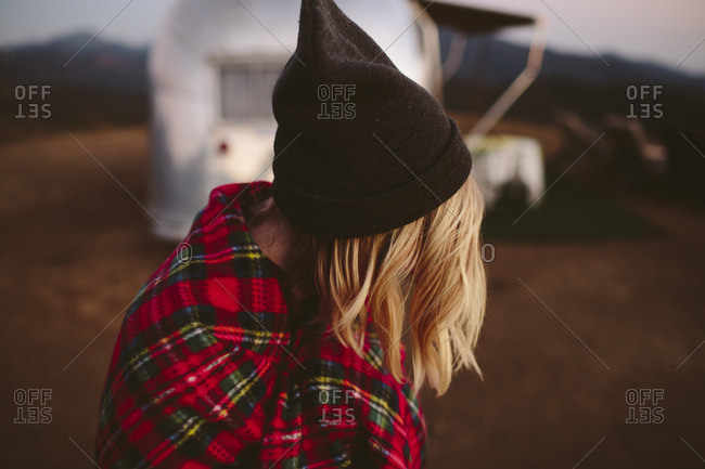 Woman with beanie and plaid blanket