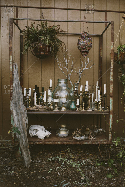 Vintage candles and antiques on cart