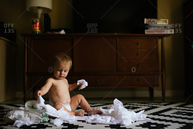 Baby making mess with wipes