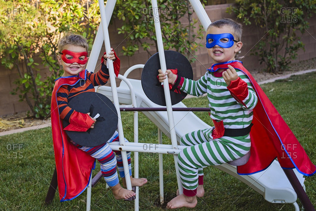 Two boys in superhero costumes