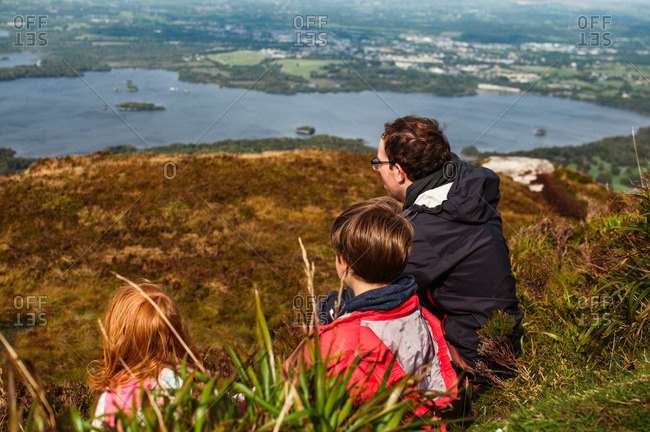 Family looking at view from mountain