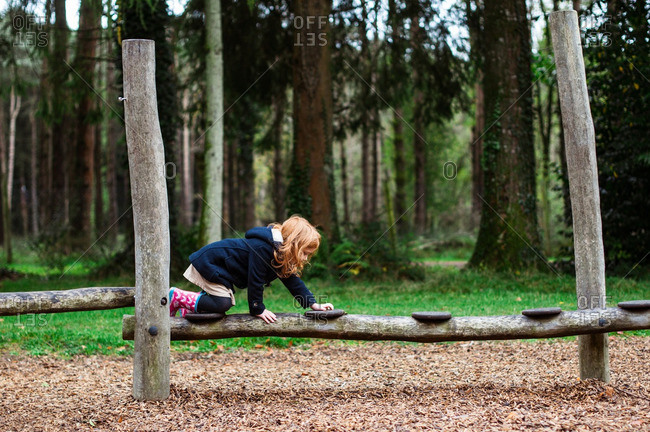 Girl crawling on an obstacle course